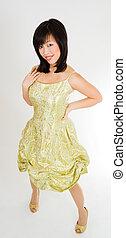 Asian girl in gold dress