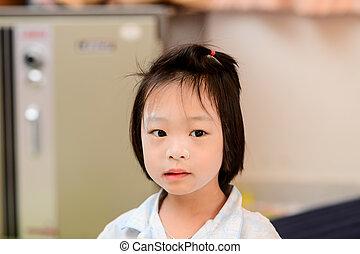 Asian girl in pajamas.