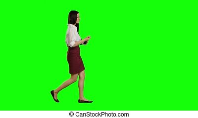 Asian girl listening to music in white headphones. Green screen