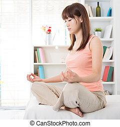 Asian girl meditating