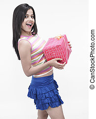 indian origin with a gift box - asian girl of indian origin...