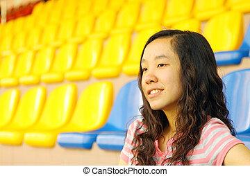 Asian girl on stadium