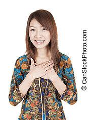 traditional malay greeting - asian girl on traditional malay...
