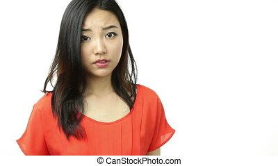 asian girl orange sundress isolated on white confused with...