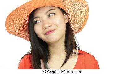 asian girl orange sundress isolated on white happy with...