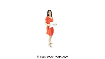 asian girl orange sundress isolated on white with vote sign...