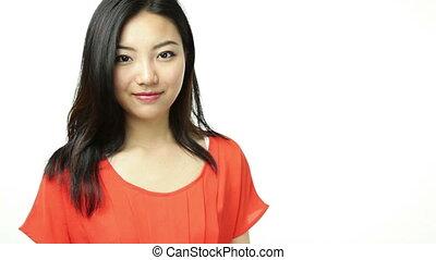 asian girl orange sundress isolated on white with help...