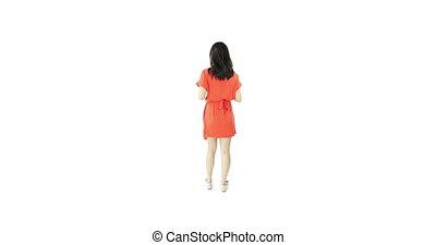 asian girl orange sundress isolated on white with thanks...