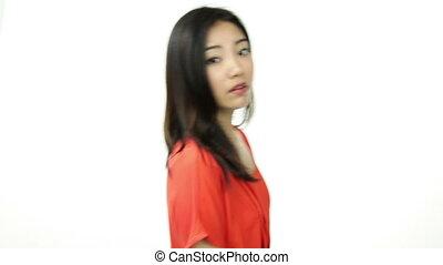 asian girl orange sundress isolated on white thinking...