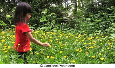 Asian Girl Picking Yellow Flowers