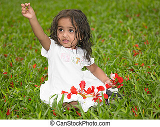 Asian girl playing in the garden