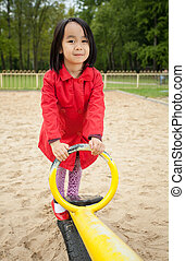 Asian girl playing in the playground