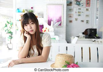 Asian girl portrait in coffee shop