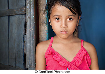 Portrait of a young girl from poverty-stricken area in Manila, the Philippines.