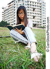 Asian girl reading in university