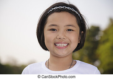 Asian girl relax and smiling happily in the park