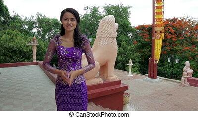 Asian Girl saluting in temple
