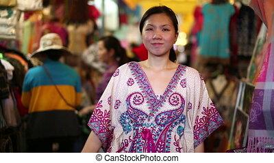 Asian girl shopping central market