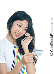 Asian girl shopping with credit card