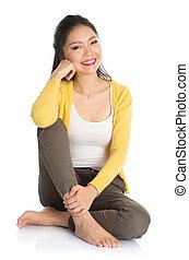 Asian girl sitting on floor