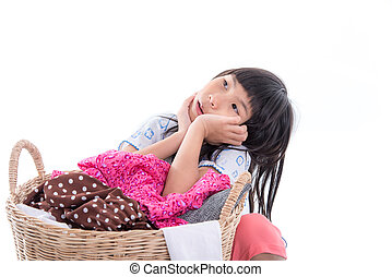 Asian girl sitting with a laundry basket isolated on white background