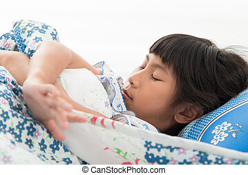 Asian girl sleeping in the bed at home.