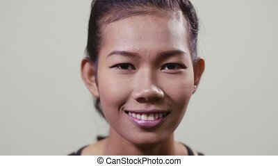 Asian girl smiling at camera, woman