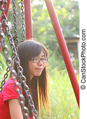 Asian girl smiling in a park