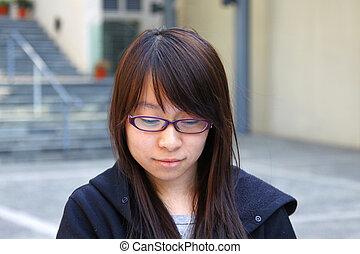 Asian girl smiling in school