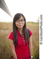 Asian girl smiling outdoor