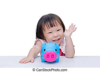 girl smiling with piggy bank