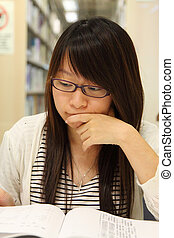 Asian girl student in library