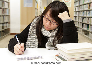 Asian girl studying in university