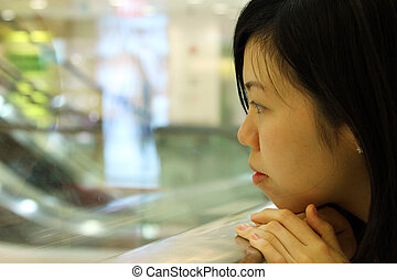 Asian girl thinking