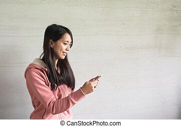 Asian girl use pad at home
