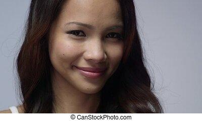 Asian girl using beauty cream