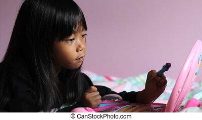 Asian Girl Using Pink Laptop Comput