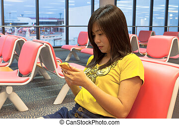 Asian girl waiting in the airport