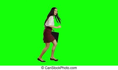 Asian girl with a briefcase in her hands is running for...