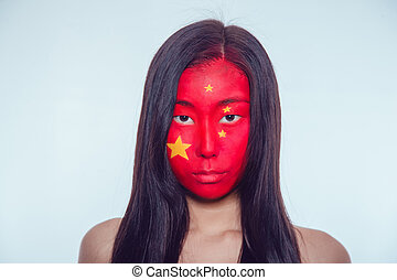 Asian girl with a Chinese flag on the face