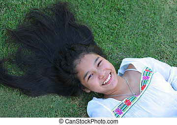 Asian girl with a wide smile