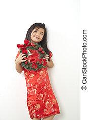 Asian girl with Christmas wreath