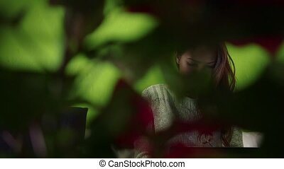 Asian girl with computer on sofa at
