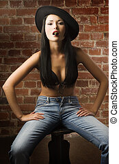 asian girl with hat and cigar