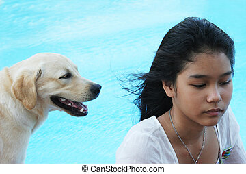 Asian girl with her pet dog (focus is on the girl).