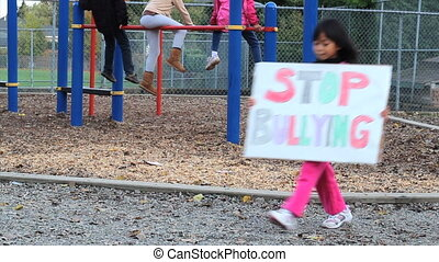 Asian Girl With Stop Bullying Sign - A cute little 5 year...