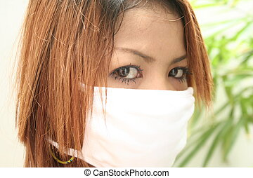 sars - asian girl with surgical mask to prevent sars
