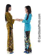 Asian girls greeting - Portrait of Malay girls with kebaya...