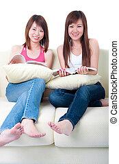 asian girls on sofa