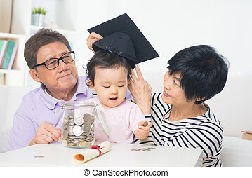 asian grand parents with grand daugther education saving concept